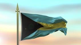 Nationsflagga av Bahamas som vinkar i vinden mot ultrarapiden för solnedgånghimmelbakgrund