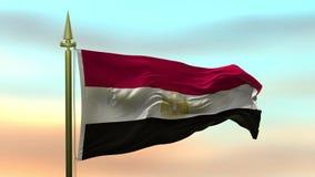 Nationsflagga av Egypten som vinkar i vinden mot öglan för ultrarapid för solnedgånghimmelbakgrund den sömlösa