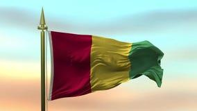 Nationsflagga av Guinea som vinkar i vinden mot öglan för ultrarapid för solnedgånghimmelbakgrund den sömlösa
