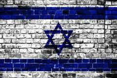 Nationsflagga av Israel på en tegelstenbakgrund arkivfoton