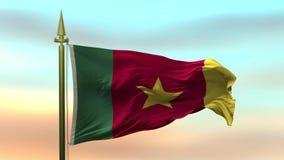 Nationsflagga av Kamerun som vinkar i vinden mot öglan för ultrarapid för solnedgånghimmelbakgrund den sömlösa