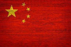 Nationsflagga av Kina på en tegelsten royaltyfri illustrationer