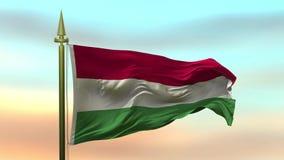Nationsflagga av Ungern som vinkar i vinden mot öglan för ultrarapid för solnedgånghimmelbakgrund den sömlösa