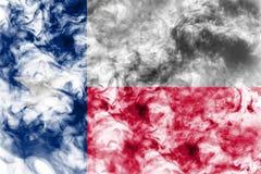 Nationsflaggan av USA-staten Texas in mot en gr? r?k p? dagen av sj?lvst?ndighet i olika f?rger av bl?tt r?tt och fotografering för bildbyråer