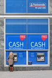 Nationwide bank. BIRMINGHAM, UK - APRIL 19, 2013: Person withdraws cash in Nationwide ATM in Birmingham, UK. Nationwide Building Society Group has 193.3 billion Stock Photography