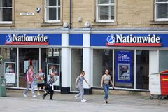 Nationwide Building Society. HUDDERSFIELD, UK - JULY 10, 2016: People walk by Nationwide Building Society branch in Huddersfield, UK. NBS is the largest building Stock Photos