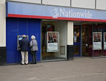 Nationwide Building Society in Staines High Street Surrey. An elderly couple withdrawing cash outside Nationwide Building in Staines Surrey Uk Royalty Free Stock Image