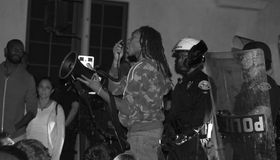 Racism Protest. Santa Barbara, CA 11/25/2014 8 PM, protest of more then 100 people in front of the Santa Barbara Police station, draws heavy police in riot gear Royalty Free Stock Photo