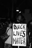 Black Lives Matter. Santa Barbara, CA 11/25/2014 8 PM, protest of more then 100 people in front of the Santa Barbara Police station, draws heavy police in riot Royalty Free Stock Image