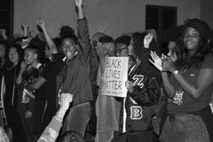 Black Lives Matter. Santa Barbara, CA 11/25/2014 8 PM, protest of more then 100 people in front of the Santa Barbara Police station, draws heavy police in riot Royalty Free Stock Photo