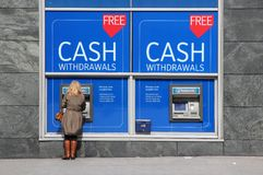 Nationwide UK. BIRMINGHAM, UK - APRIL 19, 2013: Person withdraws cash in Nationwide ATM in Birmingham, UK. Nationwide Building Society Group has 193.3 billion Royalty Free Stock Image