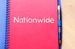 Nationwide write on notebook. Nationwide text concept write on notebook with pen Stock Photos
