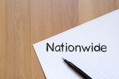Nationwide write on notebook. Nationwide text concept write on notebook with pen Stock Image