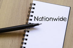 Nationwide write on notebook. Nationwide text concept write on notebook with pen Royalty Free Stock Photo