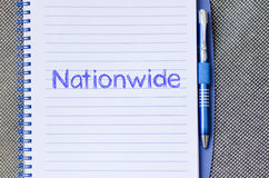 Nationwide write on notebook. Nationwide text concept write on notebook with pen Stock Photography