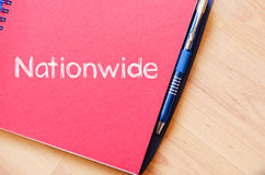 Nationwide write on notebook. Nationwide text concept write on notebook with pen Stock Photo