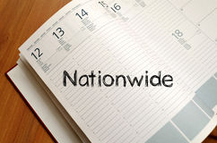 Nationwide write on notebook. Nationwide text concept write on notebook with pen Stock Images