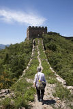 Nativ Woman walking on Great Wall Royalty Free Stock Photos