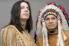 Native american. Portrait of two native americans in a studio Royalty Free Stock Photo