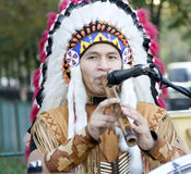 Native american. Playing music on the streets royalty free stock photos