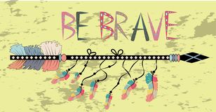 Native american accessory with arrow feathers and lettering be brave. Be brave. Inspirational quote. Modern calligraphy phrase with hand drawn arrows. Lettering royalty free stock photo