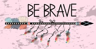 Native american accessory with arrow feathers and lettering be brave. Be brave. Inspirational quote. Modern calligraphy phrase with hand drawn arrows. Lettering stock photo