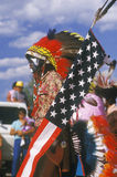 A Native American with an American flag Royalty Free Stock Photos