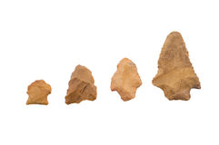 Native American arrowheads on white background. History is set with old native American artifacts Stock Photos