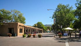 The Plaza in Santa Fe, New Mexico. Native American artists sell their wares along the sidewalk of the historic buildings and in the center plaza in Santa Fe, New stock photography
