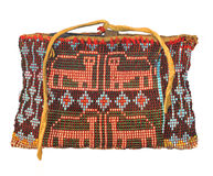 Native American beaded bag isolated. Native American Indian bag with bead decoration depicting panthers, from the Sac and Fox tribes of Oklahoma.  Isolated on Royalty Free Stock Photo