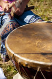 Native American child beating a drum Stock Images