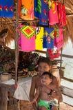Native American Children Embera Tusipono, Panama. Native Central American children from the Embera Tusipono tribe on Lake Alajuela outside Panama City sit below Royalty Free Stock Photos