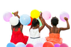 Native american  children sitting together holding color balloon Stock Photo