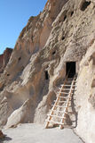 Native American cliff dwelling. Ancient native American house cut into the cliffs of Bandelier National Monument, New Mexico, USA stock photography