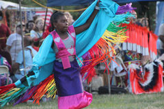 Native American Dancers at pow-wow. Glen Oaks, NY, USA - July 26, 2014: Native American Dancers at annual pow-wow at Queens County Farm Museum royalty free stock photography
