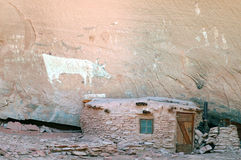Native American dwelling in Canyon De Chelly. Unusual Native American dwelling and petroglyphs in Arizonas Canyon De Chelly Stock Images