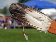Native American Feather Fan. Close up with pow wow scene background Royalty Free Stock Photos