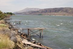 Native American fishing piers. Native American Indian fishing piers along the Columbia River, a benefit guaranteed them to fish in `the usual and accustomed Stock Image