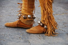 Native American Footwear. Native American suede shoes and legwear with fringe and bells Royalty Free Stock Photography