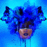 Native American girl with Wolf headdress abstract blue ice color and effect. Native American girl with Wolf headdress abstract blue ice color in our unique stock photography