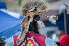 Native American head dress and clothing a Pow Wow. Native American man wearing traditional ceremonial clothing and head dress at a Pow Wow royalty free stock images