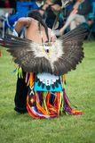 Native American head dress and clothing a Pow Wow. Native American man wearing traditional ceremonial clothing and head dress at a Pow Wow royalty free stock photos