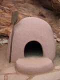 Native American Horno Oven. Horne is spanish for beehive shaped oven,. Made of adobe bricks covered with earth and straw used for baking bread. Thirty one pound Royalty Free Stock Images