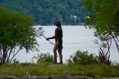 Native American hunter bronze statue Stock Images