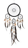 Native American Indian dreamcatcher. With a willow hoop or circle supporting a net which filters good and bad dreams which then pass down the feathers to the Stock Image