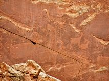Native American Indian Fremont Petroglyphs Capital Reef National Park Utah. Native American Indian Fremont Petroglyphs on Sandstone Mountain Capitol Reef Royalty Free Stock Image