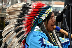 Native american indian plays flute