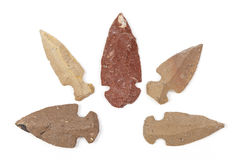 Native American Indian stone arrowheads. Native American arrowheads isolated on a white background Stock Photo