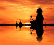 Native American Indian in the tent at sunset. Illustration of Native American Indian in the tent at sunset royalty free stock image