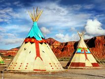 Native American Indian Tents Teepee. Native American Indian tents - teepee, decorated with ornaments in desert landscape. USA stock photos